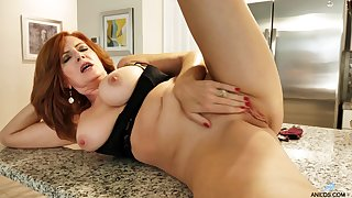 redhead mature slut Andi James drops her clothes in the kitchen