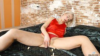 Blonde beauty pleases herself in sensual intimacy