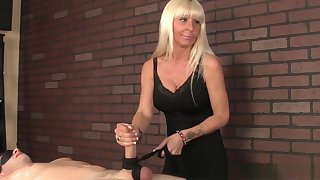 Cougar Masseuse Wanking Cock In Cbt Action