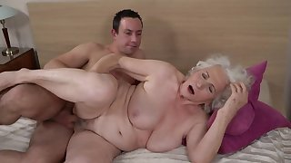 Grey-haired womanlike gets her hairy cunt fucked by younger varlet