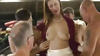 A redhead gets gangbanged at the auto garage